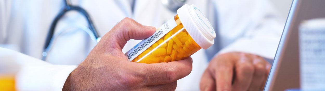 Doctor with Prescription Bottle